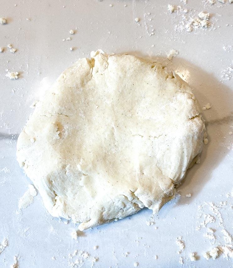 flattened disc of cream cheese pie crust