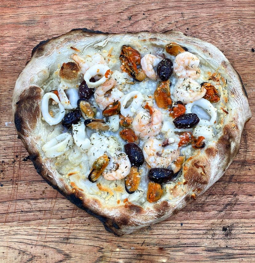 our heart shaped seafood pizza on wooden board!