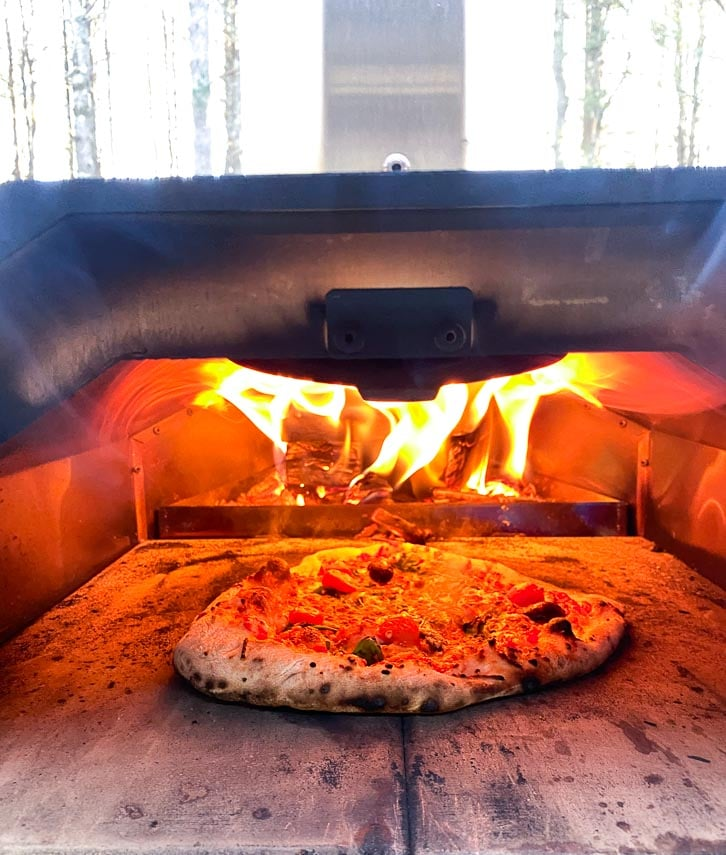 pizza in wood fired oven - Ooni Pro