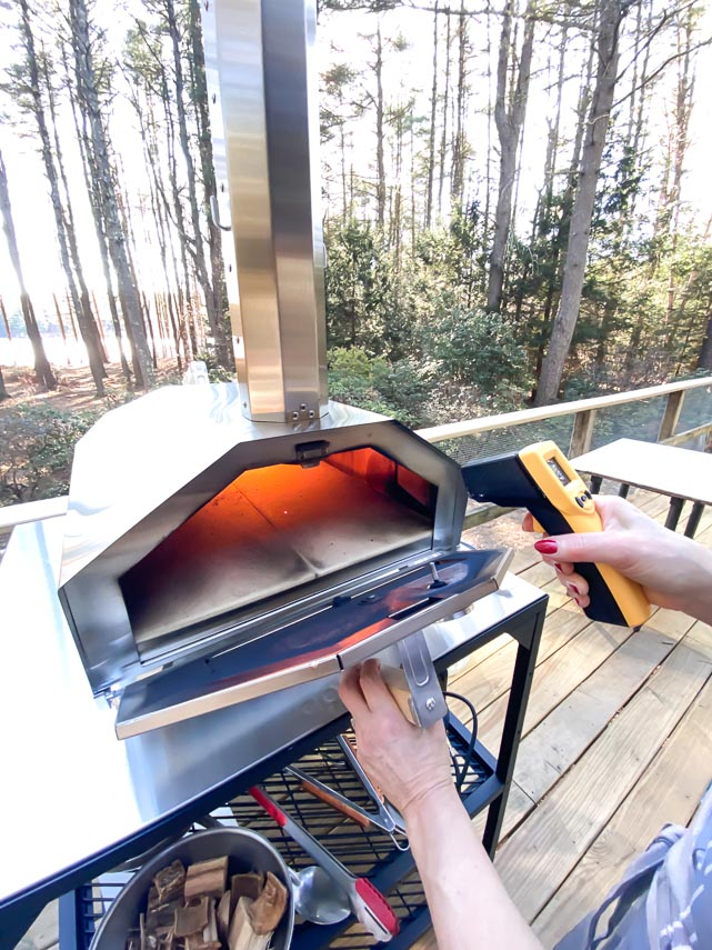 using Thermapen to test pizza deck temperature