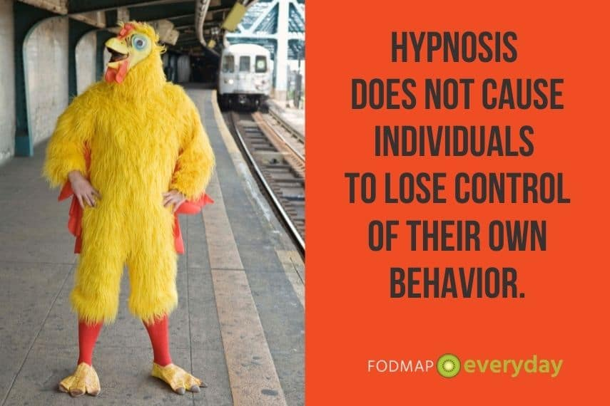 Hypnotherapy does not cause individuals to lose control of their own behavior. Man standing at a train station in a chicken outfit.