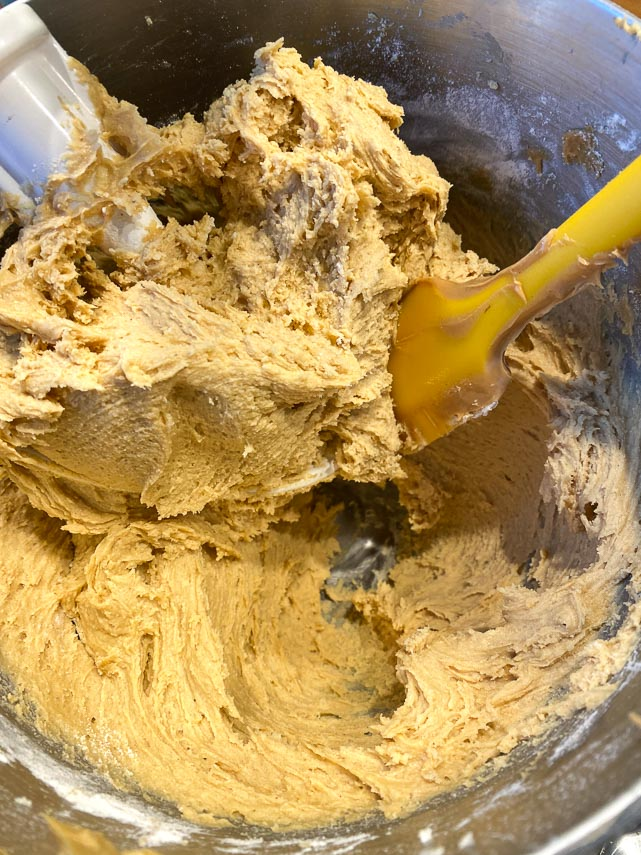 finished batter for peanut butter bars in bowl with spatula