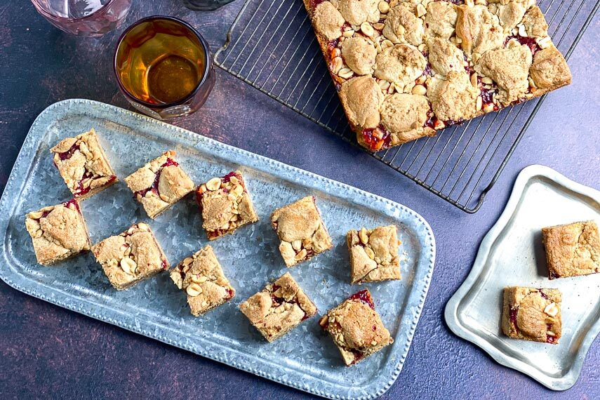 overhead horizontal image of peanut butter and jelly bars on rack and silver trays