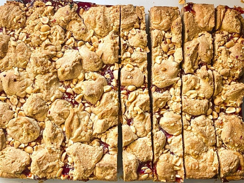 overhead image of peanut butter and jelly bars being cut