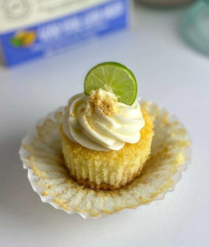 closeup of Low FODMAP Key Lime Cupcake, wrapper peeled away