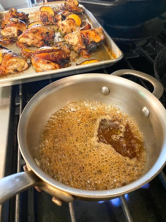 reducing peach syrup in small saucepan