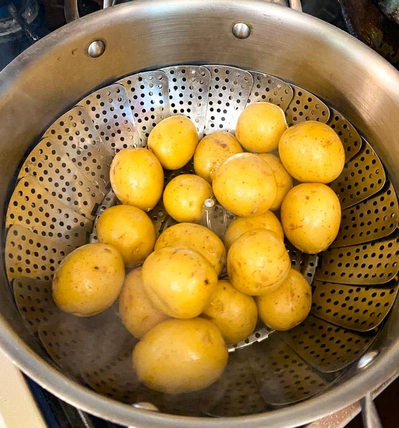 small potatoes in steamer basket